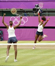 &lt;p&gt;US Venus Williams (L) and Serena Williams celebrate after winning the women&#39;s doubles gold medal match of the London 2012 Olympic Games by defeating Czech Republic&#39;s Andrea Hlavackova and Lucie Hradecka, at the All England Tennis Club in Wimbledon, southwest London.&lt;/p&gt;