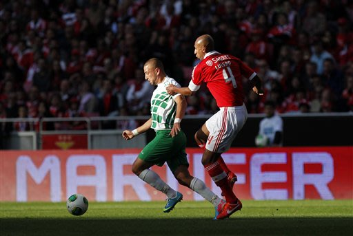 Benfica's Luisao, right, from Brazil, vies for the ball with Moreirense's Nabil Ghilas, from Algeria, during their Portuguese league soccer match at Benfica's Luz stadium in Lisbon, Sunday, May 19, 20