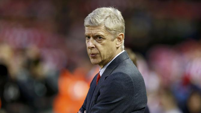 Arsenal manager Arsene Wenger looks on before their English Premier League soccer match against Liverpool at Anfield in Liverpool
