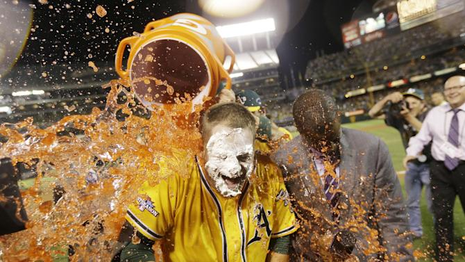 Oakland Athletics' Stephen Vogt gets a Gatorade shower after making the game-winning hit to beat the Detroit Tigers 1-0 in Game 2 of the American League baseball Division Series in Oakland, Calif., Saturday, Oct. 5, 2013. (AP Photo/Marcio Jose Sanchez)
