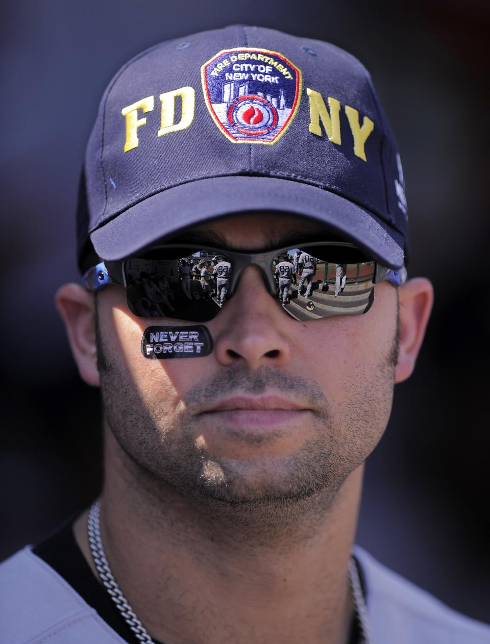 New York Yankees right fielder Nick Swisher wears a FDNY hat prior to a ceremony to commemorate the 9/11 anniversary prior to the Yankees baseball game against the Los Angeles Angels, Sunday, Sept. 11, 2011, in Anaheim, Calif. (AP Photo/Mark J. Terrill)