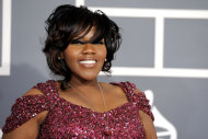 Kelly Price arrives at the 54th annual Grammy Awards on Sunday, Feb. 12, 2012 in Los Angeles. (AP Photo/Chris Pizzello)