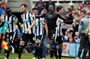 Newcastle United's Moussa Sissoko, center, celebrates his goal with head coach John Carver, right, and his teammates during the English Premier League soccer match between Newcastle United and West Ham United's at St James' Park, Newcastle, England, Sunday, May 24, 2015. (AP Photo/Scott Heppell)