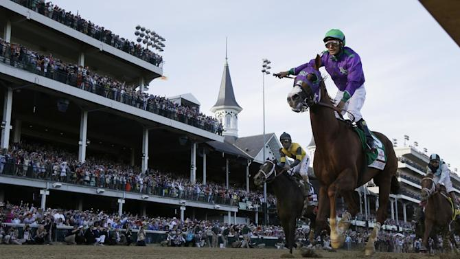 Victor Espinoza rides California Chrome to a victory during the 140th running of the Kentucky Derby horse race at Churchill Downs Saturday, May 3, 2014, in Louisville, Ky. (AP Photo/David J. Phillip)