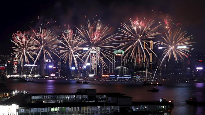 Fireworks explode over the Victoria Harbour of Hong Kong, to celebrate the Lunar New Year of the Monkey