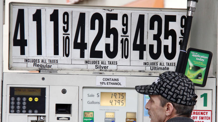In this March 2, 2012 photo, Al Milani of Staten Island, pumps gas in Manhattan at a BP mini-mart. Higher gas costs drove U.S. wholesale prices up last month. But excluding the big jump in gas, inflation was mostly tame. (AP Photo/Gene J. Puskar)