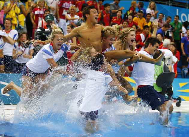 Britain's Tom Daley is thrown into the pool by the British diving team after he won the bronze medal in the men's 10m platform final at the London 2012 Olympic Games at the Aquatics Centre