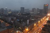 A general view the skyline of the south west Chinese city of Chengdu, Sichuan province, at dusk on January 12, 2012. The capital of Sichuan, Chengdu has been selected to host a meeting of top executives from the world's 500 leading corporations next year, Fortune magazine announced