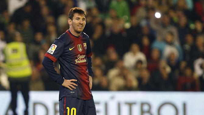 Barcelona's Lionel Messi from Argentina looks on against Betis during their La Liga soccer match at the Benito Villamarin stadium, in Seville, Spain on Sunday, Dec. 9, 2012. (AP Photo/Angel Fernandez)
