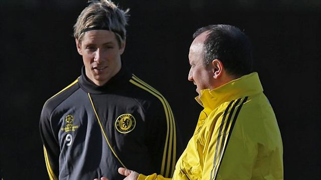 Chelsea's interim head coach Rafael Benitez (R) talks to Fernando Torres during a team training session at their training ground in Cobham, south of London December 4, 2012