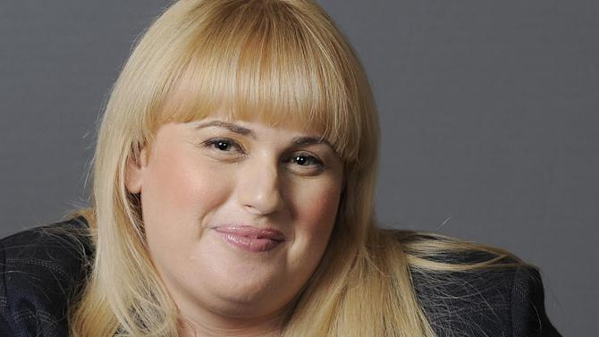 "FILE - In this Thursday, Aug. 23, 2012 file photo, actress, writer and comedienne, Rebel Wilson, a cast member in the film ""Bachelorette,"" poses for a portrait at the Four Seasons Hotel in Beverly Hills, Calif.  MTV says it tapped the Australian actress to host its annual movie awards, set for April 14, 2013, in Culver City, Calif. The network made the announcement late Thursday, Dec. 20, 2012, during the finale of its popular ""Jersey Shore"" series. (Photo by Chris Pizzello/Invision/AP, File)"