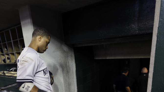 New York Yankees' Robinson Cano leaves the dugout after Game 4 of the American League championship series against the Detroit Tigers, Thursday, Oct. 18, 2012, in Detroit. The Tigers won 8-1 and moves on to the World Series. (AP Photo/Paul Sancya )