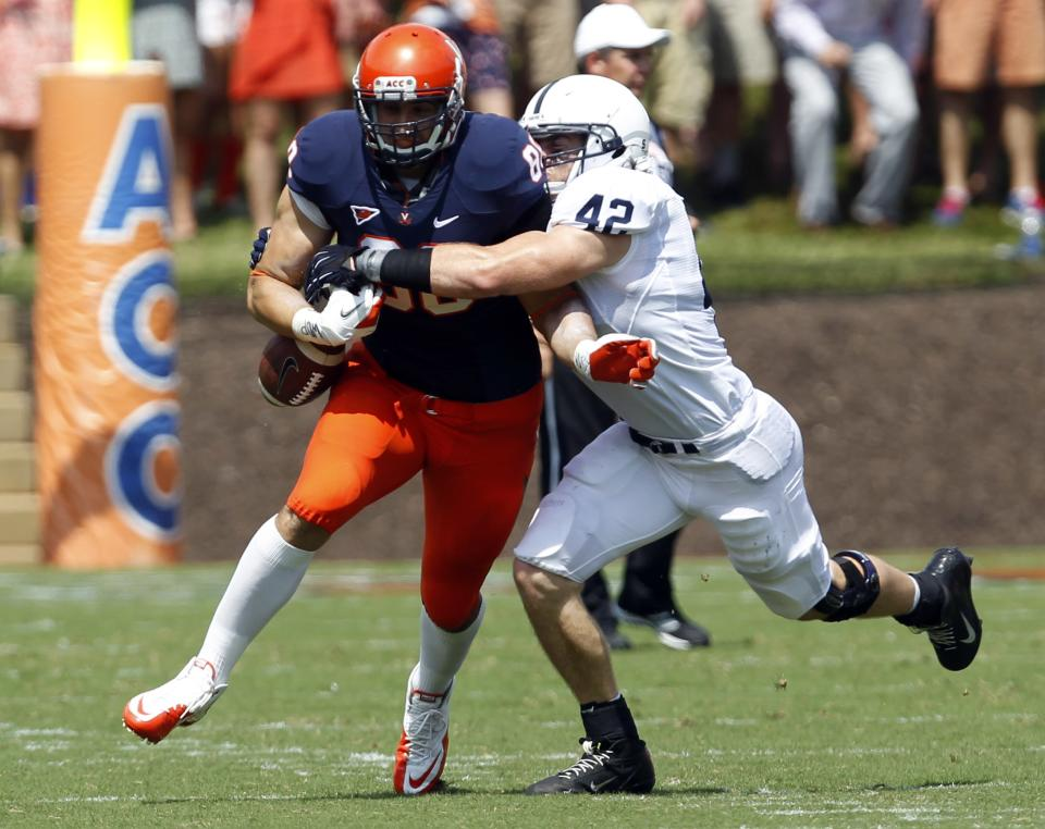 Penn State linebacker Michael Mauti (42) causes Virginia tight end Paul Freedman (88) to fumble the ball during the first half of an NCAA college football game Saturday Sept. 8, 2012, in Charlottesville, Va. (AP Photo/Andrew Shurtleff