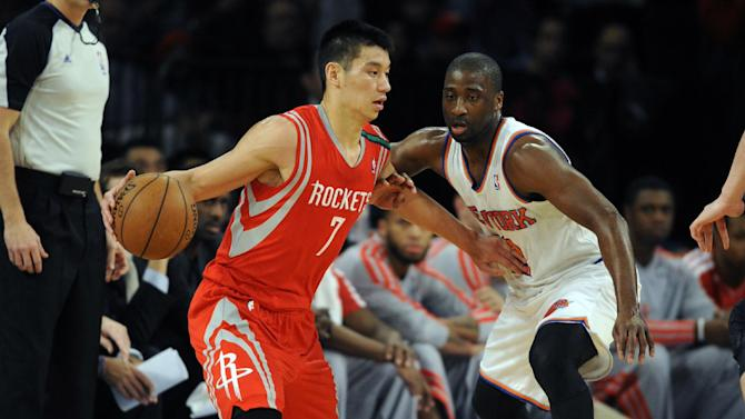 Houston Rockets' Jeremy Lin, left, drives on New York Knicks' Raymond Felton in the first quarter of an NBA basketball game at Madison Square Garden in New York, Monday, Dec. 17, 2012. (AP Photo/Henny Ray Abrams)