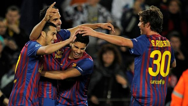 Barcelona&#39;s forward Pedro Rodriguez, Barcelona&#39;s Martin Montoya, Barcelona&#39;s Marc Bartra and Barcelona&#39;s Sergi Roberto celebrate after scorimg a goal during the Champions League football match between FC Barcelona and Bate Borissov at the Camp Nou stadium