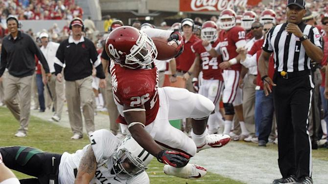 Oklahoma running back Damien Williams (26) is upended by Baylor safety Mike Hicks (17) short of the goal line in the second quarter of an NCAA college football game in Norman, Okla., Saturday, Nov. 10, 2012. (AP Photo/Sue Ogrocki)