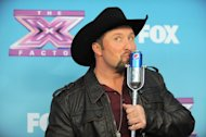 "Tate Stevens, winner of ""X Factor"" season 2, attends the season finale results show at CBS Television City on Thursday, Dec. 20, 2012, in Los Angeles. (Photo by Jordan Strauss/Invision/AP)"