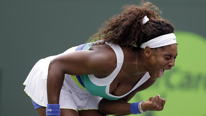 Serena Williams reacts after winning a point against Dominika Cibulkova, of Slovakia, during the Sony Open tennis tournament, Monday, March 25, 2013, in Key Biscayne, Fla. Williams won 2-6, 6-4, 6-2. (AP Photo/Lynne Sladky)