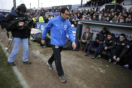 Wigan Athletic's coach Martinez reacts ahead of their English FA Cup soccer match against Macclesfield Town in Macclesfield