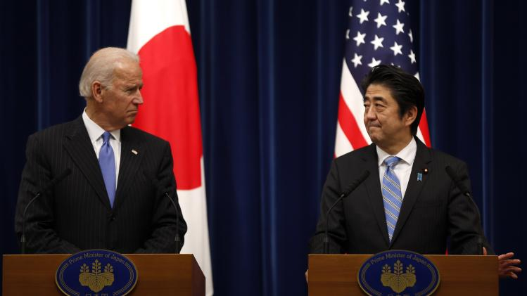 U.S. Vice President Joe Biden and Japan's Prime Minister Shinzo Abe attend a joint news conference following their meeting at the prime minister's official residence in Tokyo
