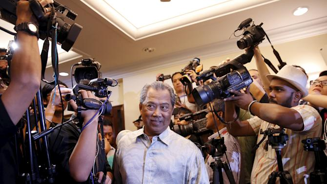 Former Malaysian Deputy Prime Minister Muhyiddin Yassin arrives to speak to the media after he was sacked during yesterday's cabinet reshuffle in Kuala Lumpur, Malaysia