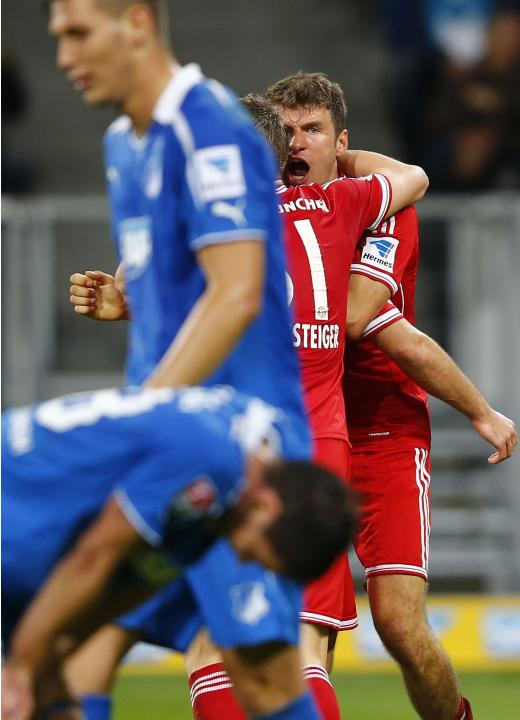 Bayern Munich's Mueller celebrates after scoring his team's second goal against TSG Hoffenheim during their German first division Bundesliga soccer match in Sinsheim