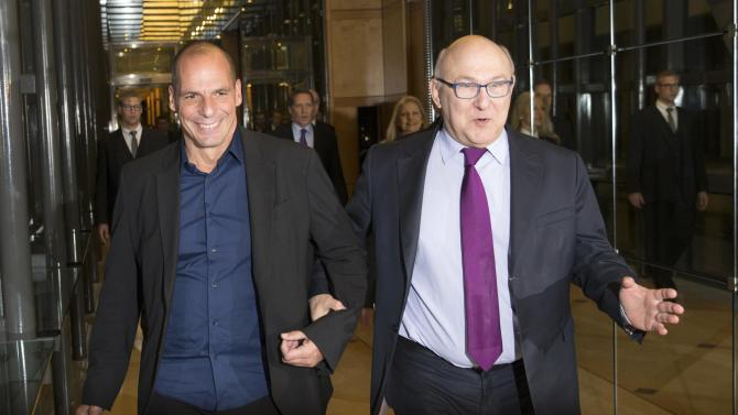 French Finance Minister Sapin and Greek Finance Minister Varoufakis arrive at a joint news conference in Paris