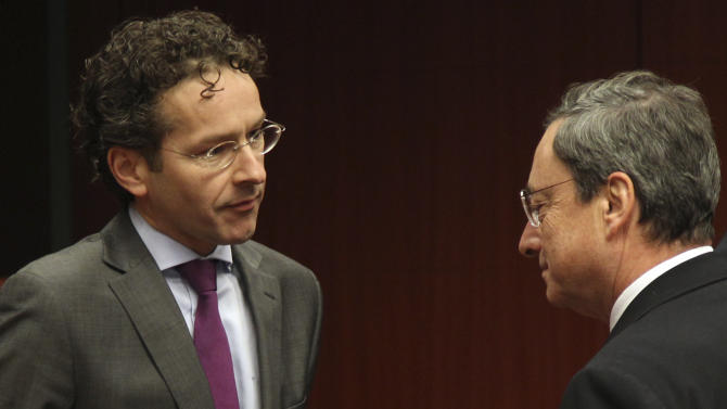 In this Monday, Nov. 12, 2012 file photo, President of the European Central Bank Mario Draghi, right, talks with Dutch Finance Minister Jeroen Dijsselbloem, left, during the Eurogroup finance ministers meeting in Brussels. On Thursday, Jan. 10, 2012, the outgoing leader of the eurogroup, Jean-Claude Juncker, gave the clearest indication yet that his successor will likely be Dutch finance minister Jeroen Dijsselbloem. Dijsselbloem's name to lead the so-called eurogroup has been going round diplomatic circles for a few weeks and the minister has just finished a tour of several eurozone countries to discuss current financial issues. Juncker said the appointment will be made Jan. 21, 2013. (AP Photo/Yves Logghe, File)