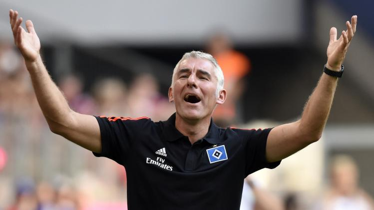 Hamburg SV's head coach Slomka reacts during the German Telekom Cup soccer match against VfL Wolfsburg in Hamburg