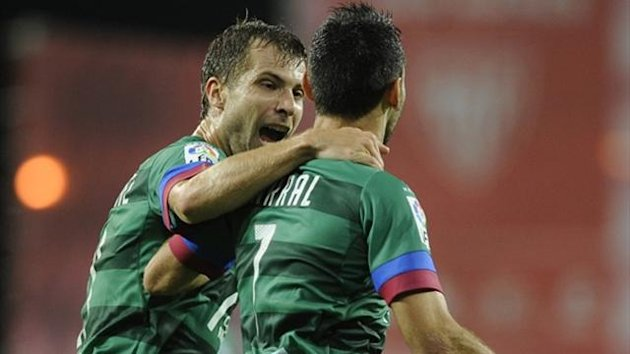 Levante midfielder David Barral celebrates with team-mate Andreas Ivanschitz (AFP)