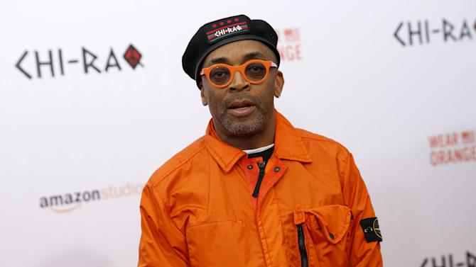 "Spike Lee poses on the red carpet at the premiere of ""Chi-Raq"" in New York"