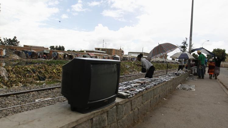 A television set is displayed on sale along Andriantany waste water channel in Antananarivo