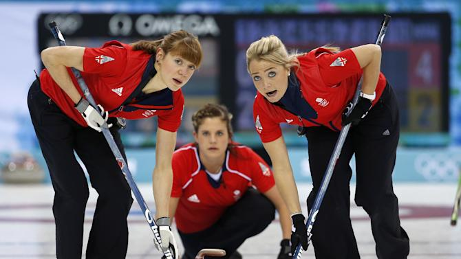 Britain's Claire Hamilton, left, and Anna Sloan, right, look to the house while sweeping a delivery by Vicki Adams, center during women's curling competition against South Korea at the 2014 Winter Olympics, Saturday, Feb. 15, 2014, in Sochi, Russia