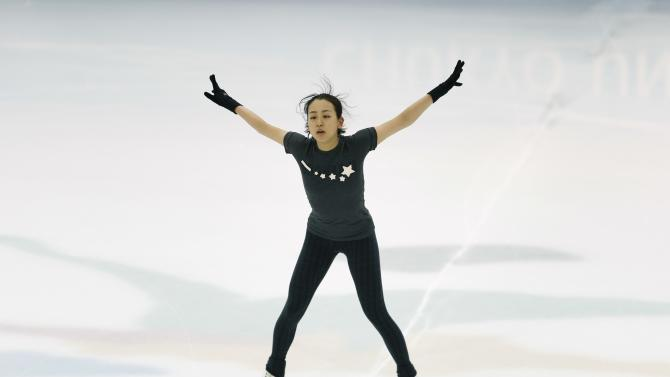 Japanese figure skater Mao Asada works out on the ice rink of the National Training Center in Toyota
