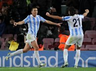 Malaga&#39;s midfielder Ignacio Camacho (L) celebrates with teammate defender Sergio Sanchez after scoring the equalizer goal during the Spanish Copa del Rey (King&#39;s Cup) quarter-final football match FC Barcelona vs Malaga CF at the Camp Nou stadium in Barcelona on January 16, 2013. The game ended in a draw 2-2
