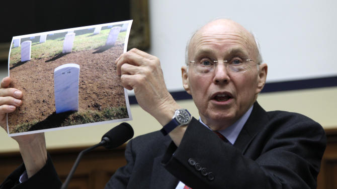 Col. WIlliam C. Koch, Jr., holds a photograph showing the location of his wife's grave at Arlington National Cemetery as he testifies on Capitol Hill in Washington, Thursday, April 14, 2011, before the House Oversight and Investigations subcommittee hearing on accountability at Arlington National Cemetery. (AP Photo/Carolyn Kaster)
