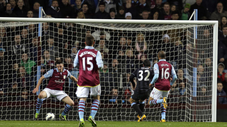 Manchester City's Carlos Tevez, no 32, shoots to score against Aston Villa during their English Premier League soccer match at the Villa Park ground in Birmingham, England, Monday, March 4, 2013. (AP Photo/Lefteris Pitarakis)