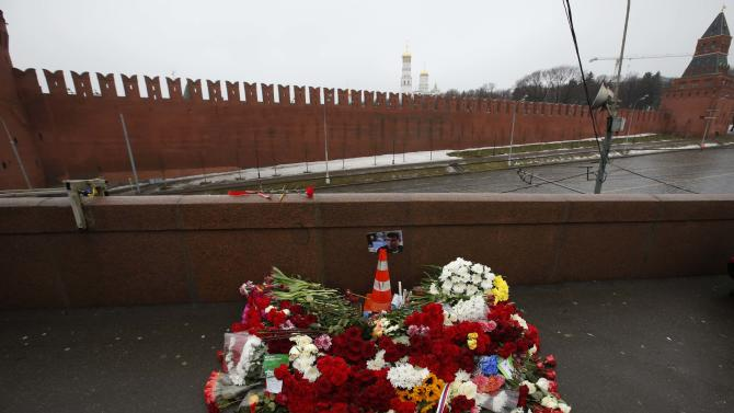 A photo, candles and flowers are placed at the site where Boris Nemtsov was shot dead, near the Kremlin in central Moscow
