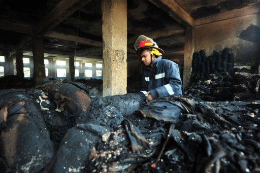 &lt;p&gt;A Bangladeshi fire-man examines burnt materials after a fire in the nine-storey Tazreen Fashion plant in Savar. Hong Kong sourcing giant Li & Fung said Sunday it was &quot;distressed&quot; by the deaths of 110 workers in a fire at a Bangladesh garment factory where it placed orders and offered compensation.&lt;/p&gt;
