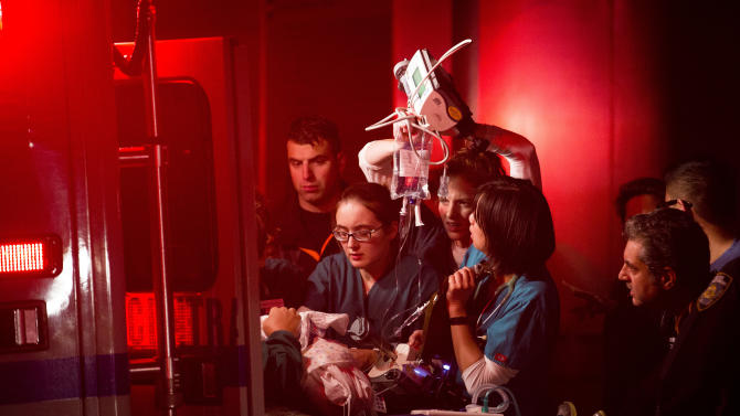 In this Oct. 29, 2012, file photo, medical workers assist a patient into an ambulance during an evacuation of NYU Langone Medical Center Monday evening during Superstorm Sandy. Two of the city's busiest, most important medical centers failed the simplest test of disaster-readiness during superstorm Sandy this week. They lost power. Their backup generators failed, or proved inadequate. Nearly 1,000 patients had to be evacuated. (AP Photo/ John Minchillo, File)