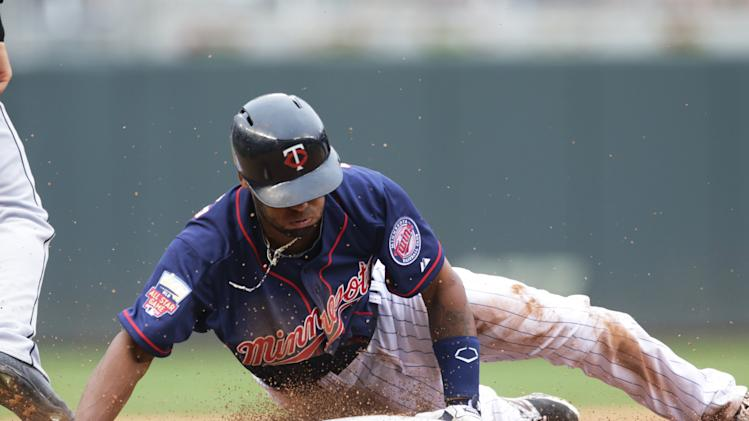 Minnesota Twins' Danny Santana slides safely into third with a triple off Detroit Tigers pitcher Kyle Lobstein in the seventh inning of a baseball game, Saturday, Aug. 23, 2014, in Minneapolis. The Twins won the game 12-4, the first of a doubleheader. (AP Photo/Jim Mone)