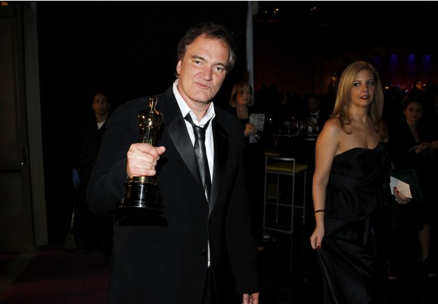 "Quentin Tarantino holds his Oscar for the Best Original Screenplay award for ""Django Unchained"", at the Governors Ball following the 85th Academy Awards in Hollywood"