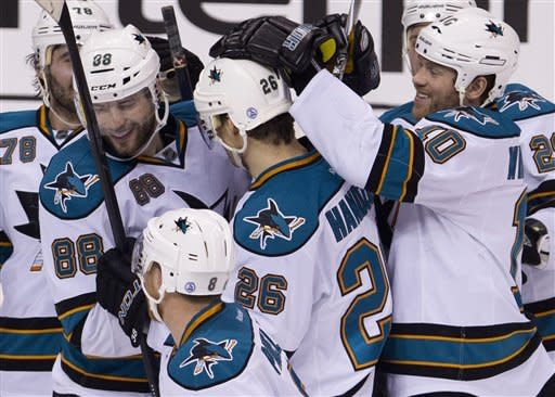 Handzus scores in SO, Sharks beat Canucks 3-2