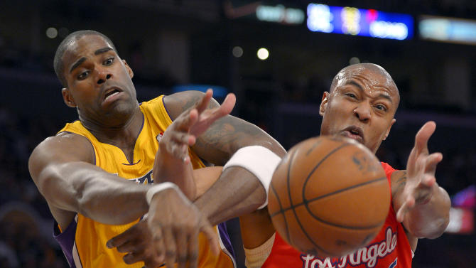 Los Angeles Lakers forward Antawn Jamison, left, and Los Angeles Clippers forward Caron Butler battle for a loose ball during the first half of their NBA basketball game, Thursday, Feb. 14, 2013, in Los Angeles.  (AP Photo/Mark J. Terrill)