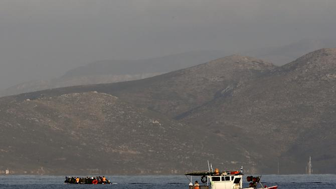 Syrian refugees overcrowd a dingy on the Aegean Sea as they try to cross from Turkey to Greece
