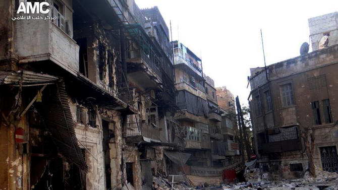 This Friday, Sept. 6, 2013 citizen journalism image provided by Aleppo Media Center AMC which has been authenticated based on its contents and other AP reporting, shows damaged residential buildings from heavy fighting between Free Syrian army fighters and government forces in Aleppo, Syria. (AP Photo/Aleppo Media Center, AMC)