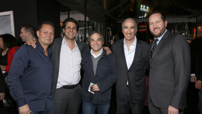 """Producer Kevin Messick, President of MGM Jonathan Glickman, President/ Paramount Film Group Adam Goodman, Chairman and CEO of MGM Gary Barber and producer Beau Flynn arrive at the premiere of """"Hansel & Gretel Witch Hunters"""" on Thursday Jan. 24, 2013, in Los Angeles.  (Photo by Todd Williamson/Invision/AP)"""