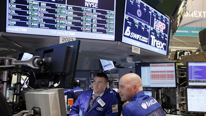 Stocks slide on a quiet day, end down for the week