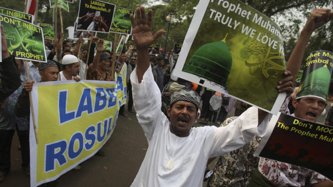 """Indonesian Muslims shout slogans during a protest against an anti-Islam film that has sparked anger among followers, outside the U.S. Embassy in Jakarta, Indonesia, Friday, Sept. 21, 2012. The U.S. has closed its diplomatic missions across Indonesia due to continuing demonstrations over the American-produced film """"Innocence of Muslims,"""" which denigrates the Prophet Muhammad. (AP Photo/Achmad Ibrahim)"""