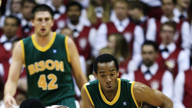 Indiana's Yogi Ferrell, left, battles North Dakota State's Lawrence Alexander for a loose ball during the first half of an NCAA college basketball game, Monday, Nov. 12, 2012, in Bloomington, Ind. (AP Photo/Darron Cummings)